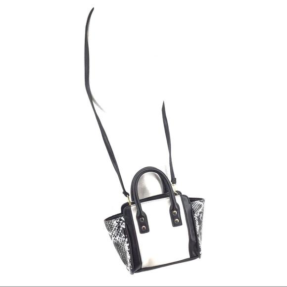 Avon Handbags - Avon snakeskin and white black trim purse